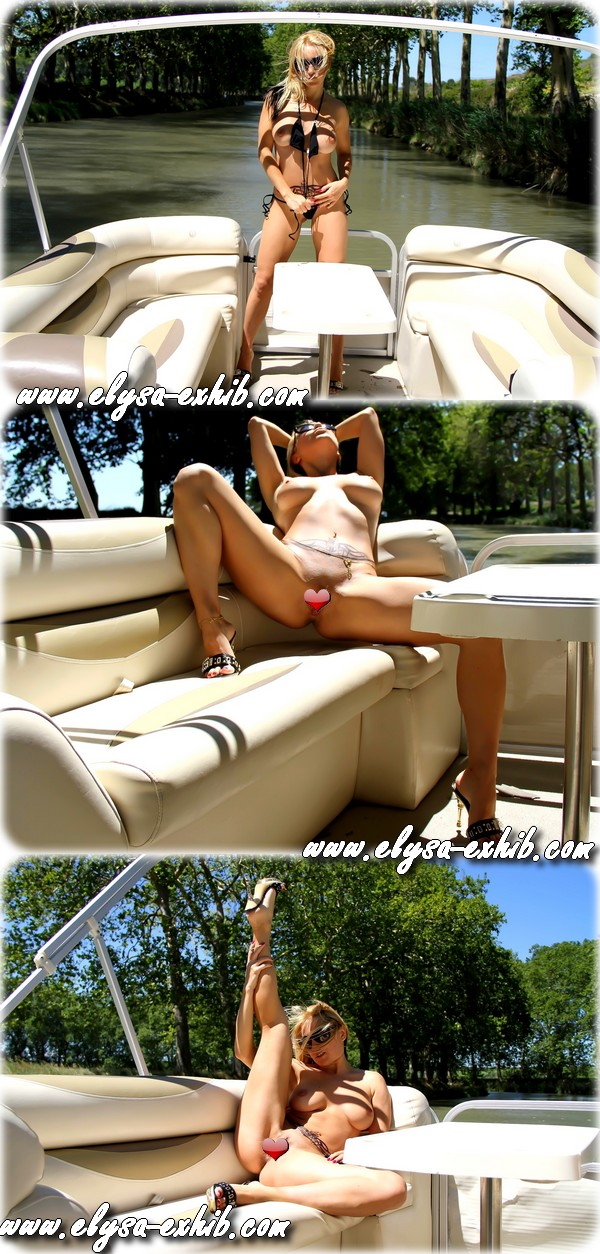 000114 Exhib et nue sur un bateau