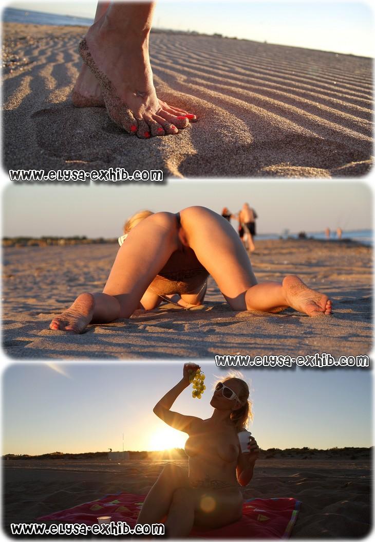 0702 Toute nue sur une plage non naturiste